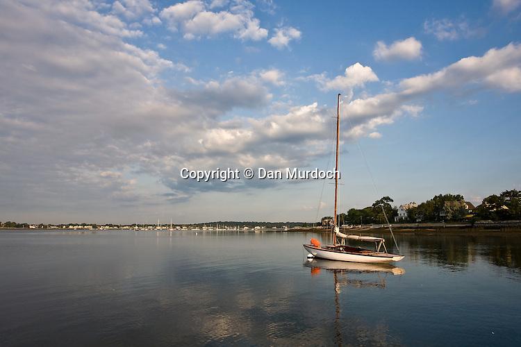 single sailboat at mooring under a morning sky