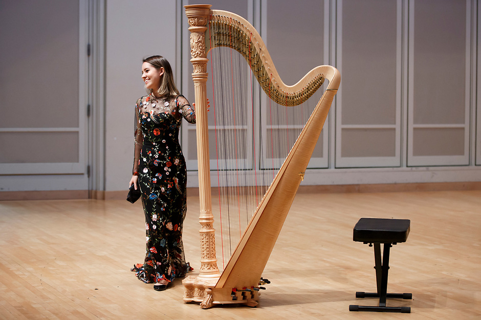 Harpist Katherine Siochi takes the stage during her laureate recital at the 11th USA International Harp Competition at Indiana University in Bloomington, Indiana on Friday, July 5, 2019. (Photo by James Brosher)