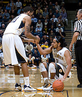 Allen Crabbe of California pulls up Jorge Gutierrez from the floor during the game against Colorado at Haas Pavilion in Berkeley, California on January 12th, 2012.   California defeated Colorado, 57-50.