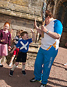 Hollywood actor and current Rector of The University of Dundee, Brian Cox, with local kids at Rosslyn Chapel with the Queen's Baton.