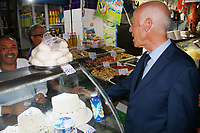 Kais Said, a Tunisian presidential candidate, speaks with people during an electoral campaign tour at an outdoor market in the capital Tunis on September 10, 2019, ahead of the first round of elections on September 15<br /> <br /> PHOTO : Agence Quebec Presse -  JDIDI_WASSIM