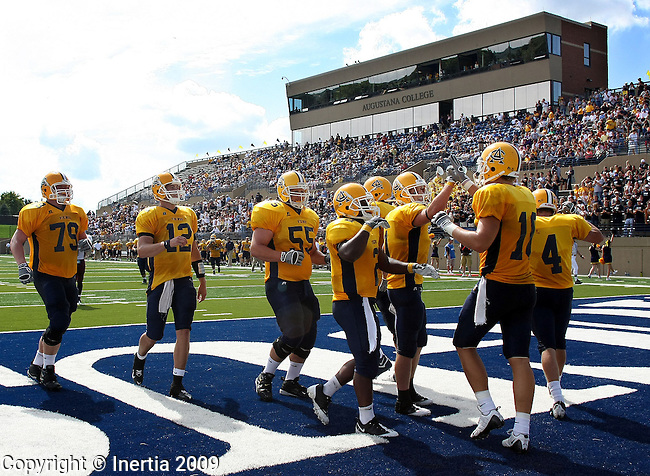 SIOUX FALLS, SD - SEPTEMBER 12:  The Augustana Vikings celebrate a 21 yard touchdown pass from Luke Butler #12 to Joe Klumper #10 in the second quarter Saturday afternoon at Kirkeby-Over Stadium. (Photo by Dave Eggen/Inertia).