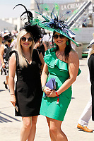 1st May 2021; Kentucky, USA;  These fans display their fancy hats while attending the 147th running of the Kentucky Derby on May 01st, 2021 at Churchill Downs in Louisville,  Kentucky, USA.