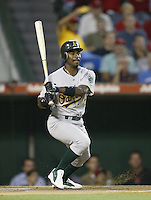 Ray Durham of the Oakland Athletics bats during a 2002 MLB season game against the Los Angeles Angels at Angel Stadium, in Anaheim, California. (Larry Goren/Four Seam Images)