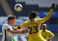 17th April 2021; Liberty Stadium, Swansea, Glamorgan, Wales; English Football League Championship Football, Swansea City versus Wycombe Wanderers; Connor Roberts of Swansea City heads the ball under pressure from Fred Onyedinma of Wycombe Wanderers