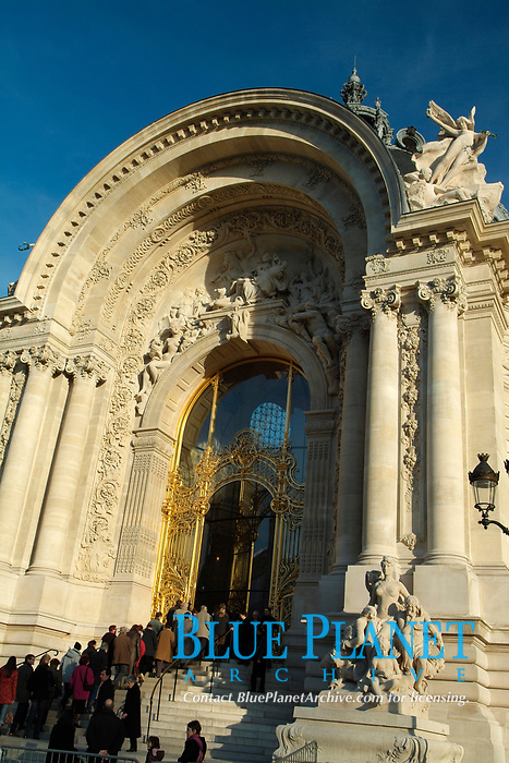 The Petit Palais (Small Palace) in Paris, Capital of France. Built for the Universal Exhibition in 1900 to Charles Girault's designs, it now houses the City of Paris Museum of Fine Arts. Arranged around an octi-circular courtyard and garden, the palace is similar to the nearby Grand Palais. Its ionic columns, grand porch and dome echo those of the Invalides across the river.
