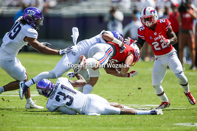 Southern Methodist Mustangs wide receiver Trey Quinn (18) and TCU Horned Frogs safety Niko Small (2) in action during the game between the SMU Mustangs and the TCU Horned Frogs at the Amon G. Carter Stadium in Fort Worth, Texas.