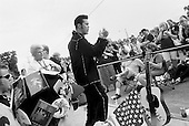 """Memphis, Tennessee<br /> USA<br /> August 15, 2002<br /> <br /> An Elvis impersonator performing """"Jail House Rock"""" before some 50, 000 Elvis fans from around the world gathered outside of Graceland for a candle vigil to mark the 25th anniversary of Elvis Presley's death."""