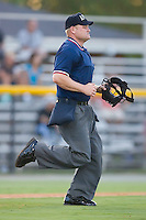 Home plate umpire Jonathan Bailey hustles to get into position to make a call during an Appalachian League game between the Princeton Rays and the Burlington Royals at Burlington Athletic Park in Burlington, NC, Monday August 11, 2008. (Photo by Brian Westerholt / Four Seam Images)