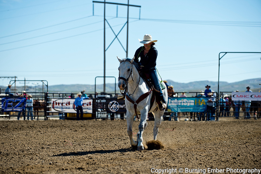 Abigail Larson in the Goat Tying event Friday morning go at the Wyoming State High School Finals Rodeo in Rock Springs Wyoming.  Photo by Josh Homer/Burning Ember Photography.  Photo credit must be given on all uses.
