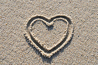 a heart painted in sand