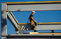 02/22/07:  A construction worker takes a break atop steel support beams during expansion/construction of a Charlotte-area shopping center. Charlotte, NC, is one of the country's fastest-growing cities. ..By Patrick Schneider- Patrick Schneider Photography.