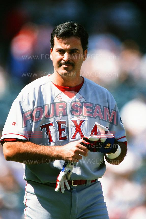Rafael Palmeiro of the Texas Rangers during a game against the Anaheim Angels at Angel Stadium circa 1999 in Anaheim, California. (Larry Goren/Four Seam Images)
