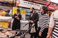 Israel,Jerusalem, an orhodox jude family is choosing the food for Shabbat in   the Mahane Yehuda Open Air Food Market,