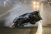 Nov 1, 2019; Las Vegas, NV, USA; NHRA top alcohol funny car driver Doug Gordon crashes during qualifying for the Dodge Nationals at The Strip at Las Vegas Motor Speedway. Gordon would be uninjured in the crash. Mandatory Credit: Mark J. Rebilas-USA TODAY Sports