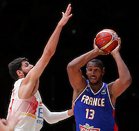 Spain's Nikola Mirotic (L) vies with France's Boris Diaw (R) during European championship semi-final basketball match between France and Spain on September 17, 2015 in Lille, France  (credit image & photo: Pedja Milosavljevic / STARSPORT)