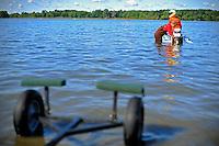 Paul Pittman readies daughter Erin's boat for the next heat.
