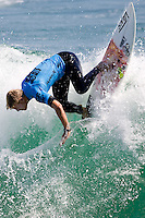 American Patrick Gudauskas with a backside lip smack during round of 48 at the 2010 US Open of Surfing in Huntington Beach, California on August 5, 2010.