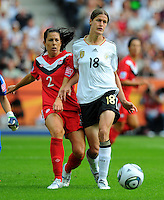 Kerstin Garefrekes (r) of Germany and Emily Zurrer of Canada during the FIFA Women's World Cup at the FIFA Stadium in Berlin, Germany on June 26th, 2011.