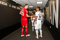 Michael Dawson of Nottingham Forest shakes hands with Wayne Routledge of Swansea City during the Sky Bet Championship match between Swansea City and Nottingham Forest at the Liberty Stadium in Swansea, Wales, UK. Saturday 14 September 2019