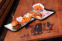 Pictured: Two of the dishes, a pulled pork burger and a hot dog Monday 15 May 2017<br /> Re: Coyote Ugly Saloon in Cardiff, Wales, UK.