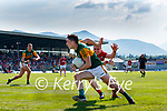Paudie Clifford, Kerry, in action against Mattie Taylor, Cork, during the Munster GAA Football Senior Championship Final match between Kerry and Cork at Fitzgerald Stadium in Killarney on Sunday.