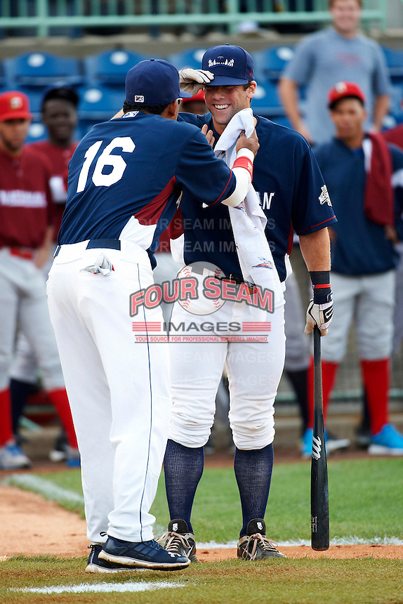 Mahoning Valley Scrappers infielder Joe Sever #8 gets some help from Charlie Valerio #16 during the home run derby before the NY-Penn League All-Star Game at Eastwood Field on August 14, 2012 in Niles, Ohio.  National League defeated the American League 8-1.  (Mike Janes/Four Seam Images)