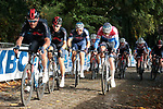 The peloton led by Luke Rowe (WAL) and team mate Michal Kwiatkowski (POL) Ineos Grenadiers and Dutch Cahmpion Mathieu Van Der Poel (NED) Alpecin-Fenix on the first ascent of the Kemmelberg during the 82nd edition of Gent-Wevelgem 2020 running 232km from Ypres to Wevelgem, Belgium. 11th October 2020.  <br /> Picture: Colin Flockton   Cyclefile<br /> <br /> All photos usage must carry mandatory copyright credit (© Cyclefile   Colin Flockton)