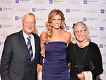 Edward and Maya Manley, founders of Making Headway Foundation, with Erin Andrews