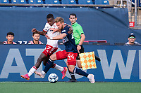 FOXBOROUGH, MA - JUNE 26: Bernard Kamungo #7 of North Texas SC and Pierre Cacet #44 of the New England Revolution battle for a ball near the sideline during a game between North Texas SC and New England Revolution II at Gillette Stadium on June 26, 2021 in Foxborough, Massachusetts.