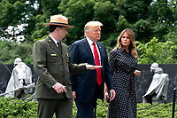US President Donald J. Trump, alongside First Lady Melania Trump, lays a wreath at the Korean War Veterans Memorial in Washington, DC, USA, 25 June 2020. On 24 June, in the wake of anti-racism protests aimed at monuments around the country, the president activated the National Guard to provide unarmed security for monuments in the nation's capital.<br /> Credit: Jim LoScalzo / Pool via CNP/AdMedia