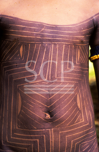 A-Ukre Village, Xingu, Brazil. Kayapo body paint; Girls tummy with geometric design; genipapu fruit dye. Para State.