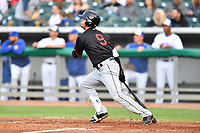 Birmingham Barons designated hitter Blake Rutherford (9) swings at a pitch during a game against the Tennessee Smokies at Smokies Stadium on May 15, 2019 in Kodak, Tennessee. The Smokies defeated the Barons 7-3. (Tony Farlow/Four Seam Images)