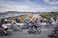 Peloton rolling through Britanny <br /> <br /> Stage 2 from Perros-Guirec to Mûr-de-Bretagne, Guerlédan (184km)<br /> 108th Tour de France 2021 (2.UWT)