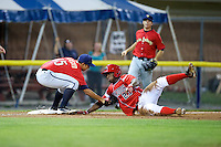 State College Spikes pitcher Orlando Castro #15 tags out Matthew Young #23 trying to go to third on an overthrow during a game against the Batavia Muckdogs at Dwyer Stadium on August 7, 2012 in Batavia, New York.  State College defeated Batavia 4-2.  (Mike Janes/Four Seam Images)