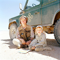 Portrait of a mother and her son. They are part of a group travelling in the Sahara to witness the 2006 Eclipse, Libya