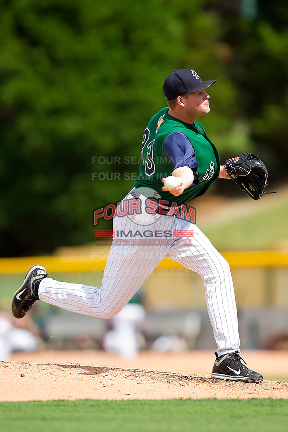 Relief pitcher Tyson Corely #33 of the Charlotte Knights in action against the Syracuse Chiefs at Knights Stadium on June 19, 2011 in Fort Mill, South Carolina.  The Knights defeated the Chiefs 10-9.    (Brian Westerholt / Four Seam Images)