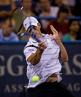 American Andy Roddick prepares hits a forehand during the Legg Mason Tennis Classic at the William H.G. FitzGerald Tennis Center in Washington, DC.  Giles Simon defeated Andy Roddick in straight sets in a thunderstorm delayed evening session.