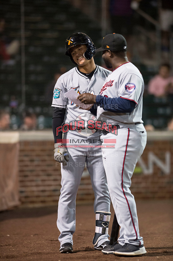 Salt River Rafters shortstop Bryson Brigman (15), of the Miami Marlins organization, jokes with manager Tommy Watkins (8), of the Minnesota Twins organization, during an Arizona Fall League game against the Mesa Solar Sox at Sloan Park on October 16, 2018 in Mesa, Arizona. Salt River defeated Mesa 2-1. (Zachary Lucy/Four Seam Images)