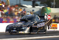 Apr 25, 2014; Baytown, TX, USA; NHRA funny car driver Alexis DeJoria during qualifying for the Spring Nationals at Royal Purple Raceway. Mandatory Credit: Mark J. Rebilas-