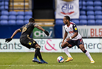 Bolton Wanderers' Nathan Delfouneso competing with Oldham Athletic's Brice Ntambwe (left) <br /> <br /> Photographer Andrew Kearns/CameraSport<br /> <br /> The EFL Sky Bet League Two - Bolton Wanderers v Oldham Athletic - Saturday 17th October 2020 - University of Bolton Stadium - Bolton<br /> <br /> World Copyright © 2020 CameraSport. All rights reserved. 43 Linden Ave. Countesthorpe. Leicester. England. LE8 5PG - Tel: +44 (0) 116 277 4147 - admin@camerasport.com - www.camerasport.com