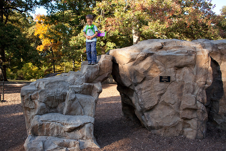 My older son, age 5, prepares to jump off the playground climbing rock. I had told him that I was sorry, but the wings would not really fly. He jumped anyway.