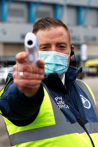 21st November 2020; The Den, Bermondsey, London, England; English Championship Football, Millwall Football Club versus Cardiff City; Safety Steward scanning temperatures outside The Den Stadium before kick off