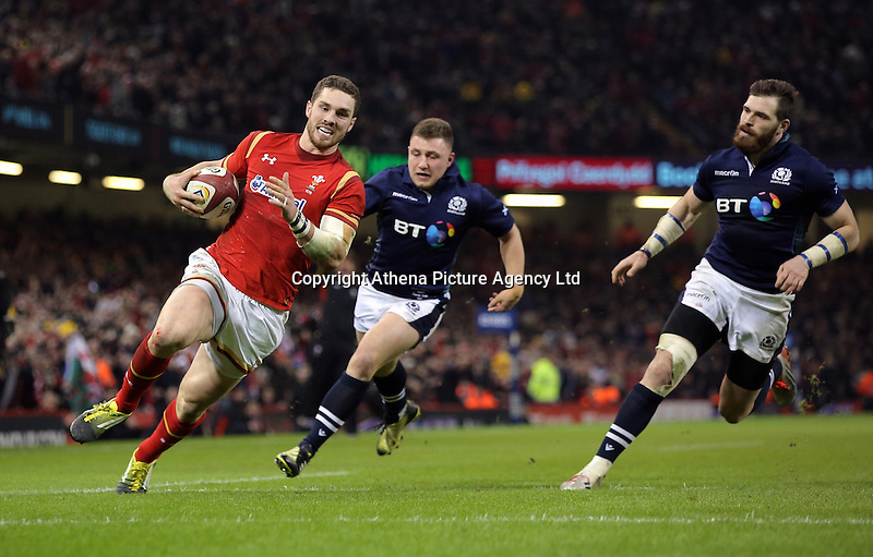 George North of Wales (L) on his final run before scoring a try during the RBS 6 Nations Championship rugby game between Wales and Scotland at the Principality Stadium, Cardiff, Wales, UK Saturday 13 February 2016