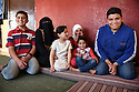 WEDAD AL-MEI'DANI, 37, WITH HER CHILDREN FROM DAMASCUS, SYRIA IN THEIR NEW HOME IN MADABA, JORDAN. 20/04016. PHOTO CLARE KENDALL.