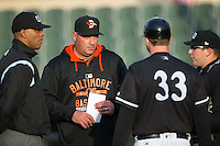 Delmarva Shorebirds manager Ryan Minor (44) and umpires Jose Navas (left) and Jason Johnson (right) listen as Kannapolis Intimidators manager Cole Armstrong (33) explains the ground rules at Kannapolis Intimidators Stadium on April 11, 2016 in Kannapolis, North Carolina.  (Brian Westerholt/Four Seam Images)