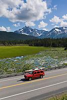 SUV travels the New Seward Highway, Kenai Peninsula southcentral, Alaska.