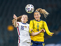 SOLNA, SWEDEN - APRIL 10: Rose Lavelle #16 of the USWNT goes up for a header with Kosovare Asllani #9 of Sweden during a game between Sweden and USWNT at Friends Arena on April 10, 2021 in Solna, Sweden.