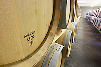 American oak barrel. Oak barrel aging and fermentation cellar. Chateau Saint Christoly, Medoc, Bordeaux, France