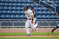 Biloxi Shuckers Cooper Hummel (9) scores a run during a Southern League game against the Montgomery Biscuits on May 8, 2019 at MGM Park in Biloxi, Mississippi.  Biloxi defeated Montgomery 4-2.  (Mike Janes/Four Seam Images)